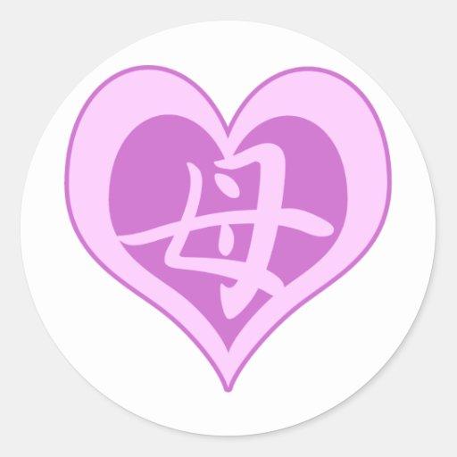 El corazón de la madre pegatina redonda