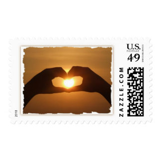 El corazón de la puesta del sol da franqueo sello
