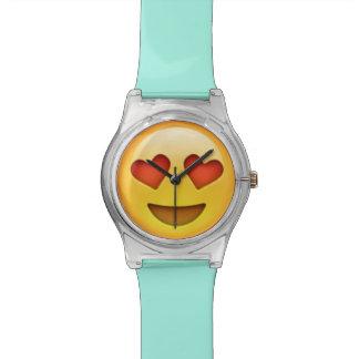El corazón observa el reloj de Emoji