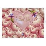 El corazón rosado del oro de las flores de la púrp