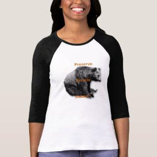 El coto, recicla, sostiene la camiseta del dos-ton
