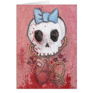 El cráneo femenino con el arco azul/muere por músi felicitación