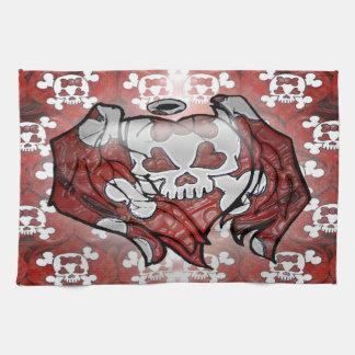El cráneo femenino y los huesos con ángel de los c toalla de cocina