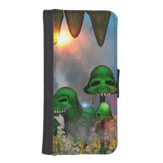 El cráneo verde divertido prolifera rápidamente billeteras para teléfono