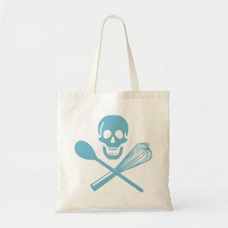 El cráneo y la cruz baten el azul de la harina de bolsa de mano