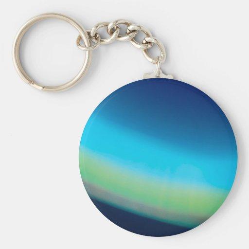 El cristal abstracto refleja el fondo del mar llavero redondo tipo pin