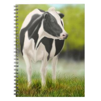 El cuaderno de la vaca de ordeño de Holstein