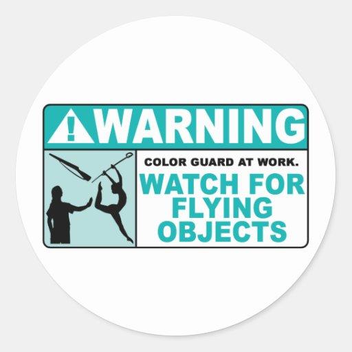 ¡El cuidado se guarda de objetos del vuelo! Etiqueta Redonda