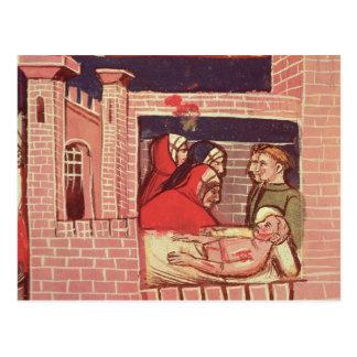 El cuidar para un hombre herido en un castillo tarjeta postal