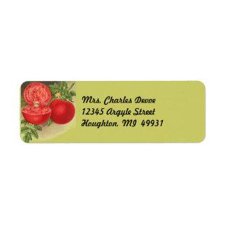 El cultivar un huerto del tomate maduro en etiquetas de remite