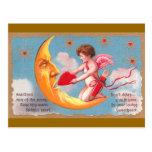 El Cupid alimenta el corazón a la tarjeta del día  Postales