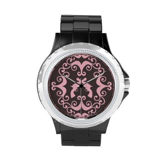 El damasco dispara contra el modelo rosado occiden reloj de mano