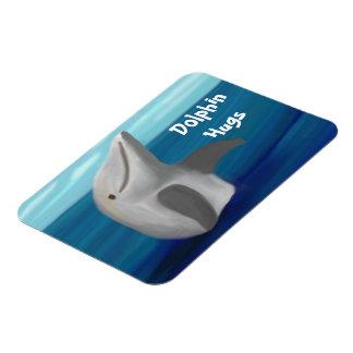 El delfín abraza el imán del premio del océano