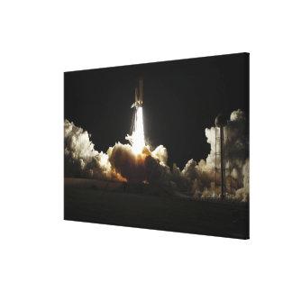 El descubrimiento del transbordador espacial quita impresión en lona