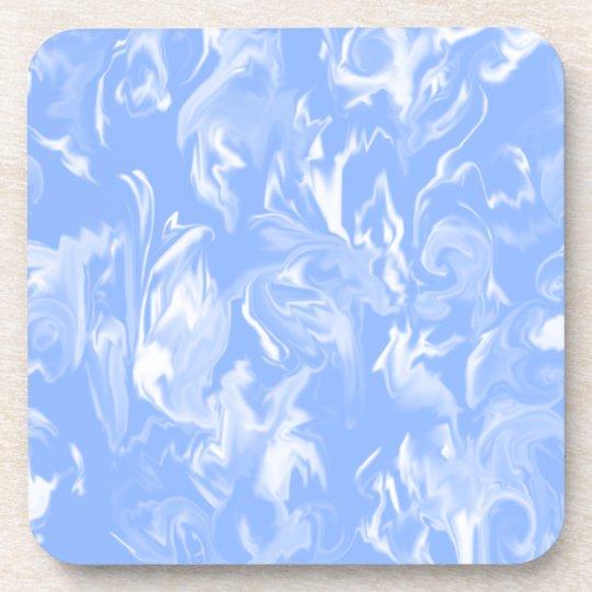 El desgin del azul y del blanco de cielo mezcló el posavaso