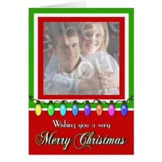 El día de fiesta de las Felices Navidad enciende l Tarjeta De Felicitación
