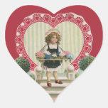 El día de San Valentín del vintage, niño con las Colcomanias Corazon