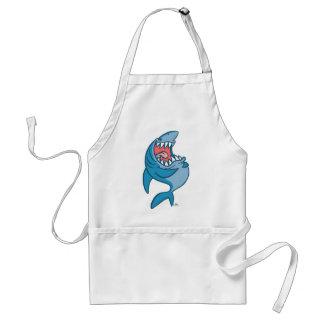 El dibujo animado de risa del tiburón que cocina e delantales