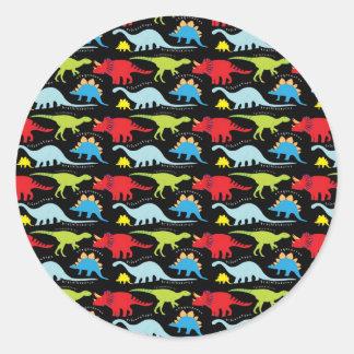 El dinosaurio diseña verde del rojo azul en negro pegatina redonda