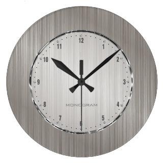 El diseño metálico de los gris plateados cepilló l reloj