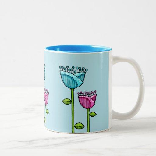 El Doodle de la diversión florece la taza rosada a