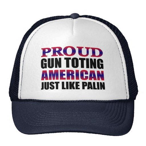 El dueño de arma americano orgulloso tiene gusto d gorros
