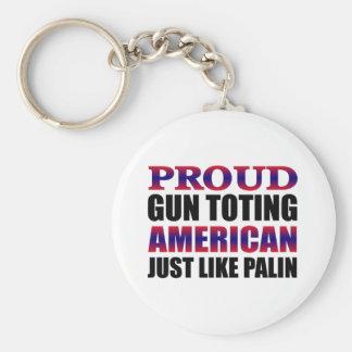 El dueño de arma americano orgulloso tiene gusto llavero redondo tipo pin