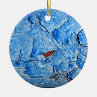 El efecto acodado de la pintura envejeció adorno redondo de cerámica