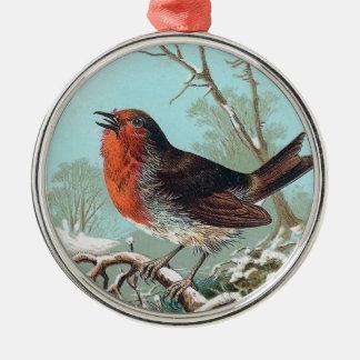 El ejemplo del pájaro del vintage del petirrojo adorno redondo plateado