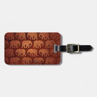 El elefante gastado siluetea el modelo, rojizo etiquetas maletas