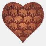 El elefante gastado siluetea el modelo, rojizo calcomanía de corazón