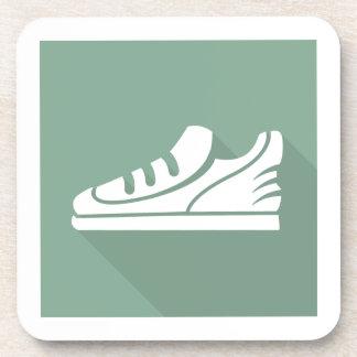 El entrenamiento se divierte el calzado atlético posavasos