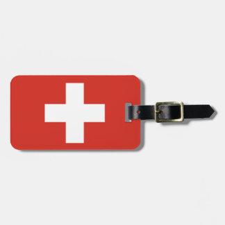 El equipaje suizo de la bandera marca con etiqueta etiqueta para maleta