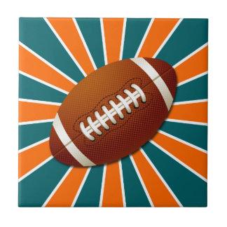 El equipo colorea fútbol retro del naranja y del t azulejo cuadrado pequeño