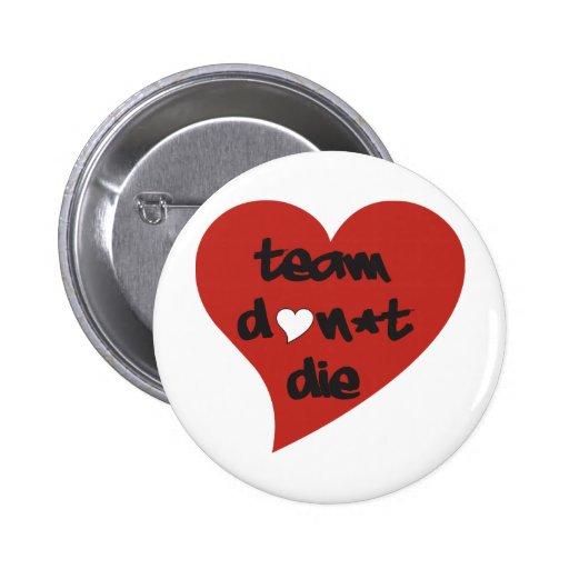 El equipo no muere corazón pins