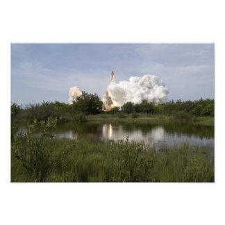 El esfuerzo del transbordador espacial quita 4 impresiones fotográficas