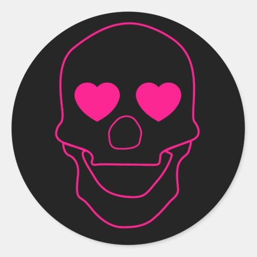 El esquema del cráneo con el corazón observa a los pegatina redonda