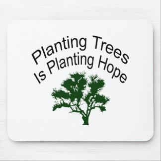 El establecimiento de árboles es establecimiento d alfombrillas de raton