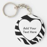 El estampado de zebra raya el corazón blanco llavero