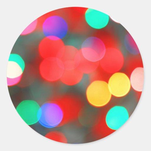 El extracto colorido enciende Bokeh Pegatina Redonda