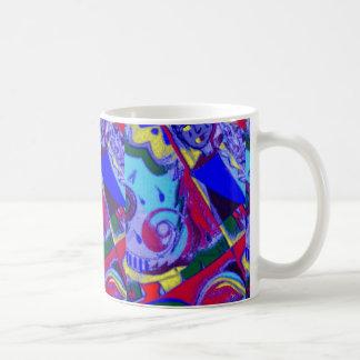 El extracto diseñó la taza colorida del café/del