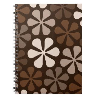 El extracto florece marrones y los bate cuaderno