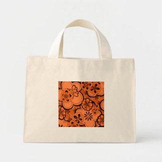 El extracto retro florece el naranja de la bolsa