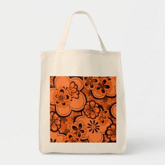 El extracto retro florece el naranja de la bolsa lienzo