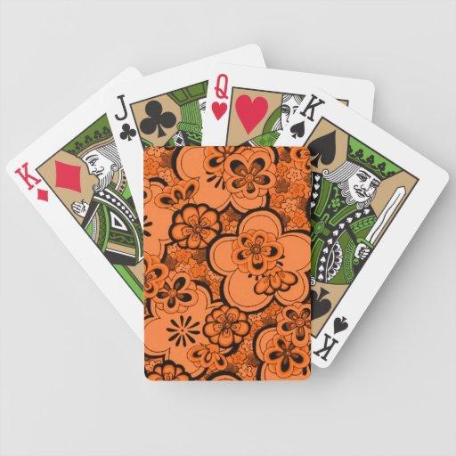 El extracto retro florece tarjetas del naranja de  barajas de cartas