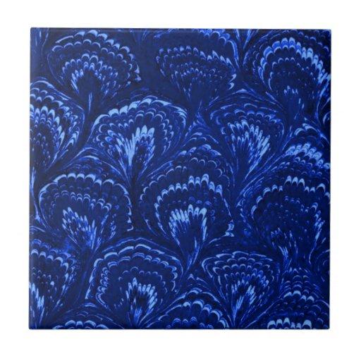 El extracto retro remolina teja del azul del zafir