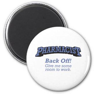 El farmacéutico/retrocede iman