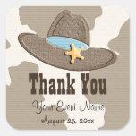 El favor azul del gorra de vaquero etiqueta a los