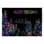 El feliz árbol de navidad enciende la tarjeta