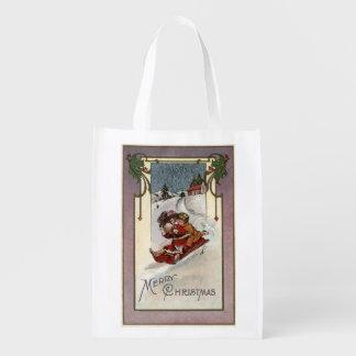 El feliz Sledding de ChristmasCouple Bolsas Para La Compra